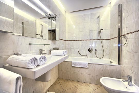 The Residence Brehova two bedroom apartment bathroom with bath