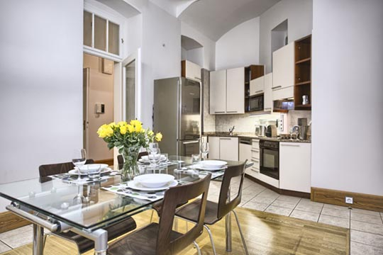 The Residence Brehova two bedroom apartment kitchen and dining room