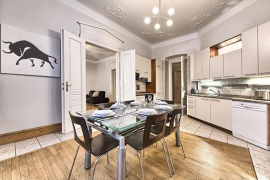 The Residence Brehova three bedroom apartment kitchen with dining table