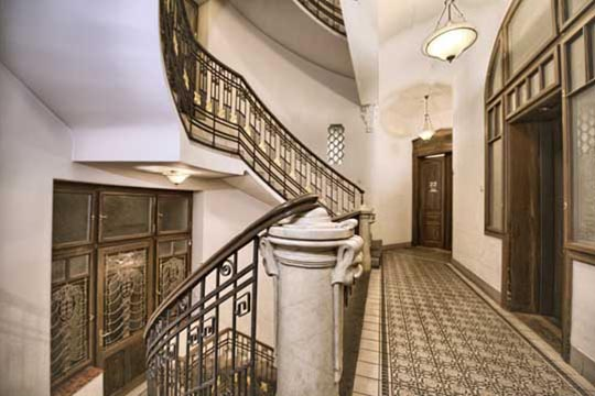 The Residence Brehova hall with staircase and elevator