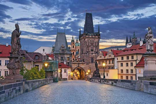Charles Bridge in Prague evening with towers and Lesser Town