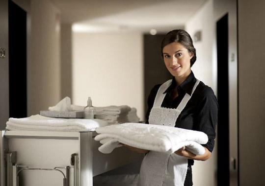 A maid with fresh towels