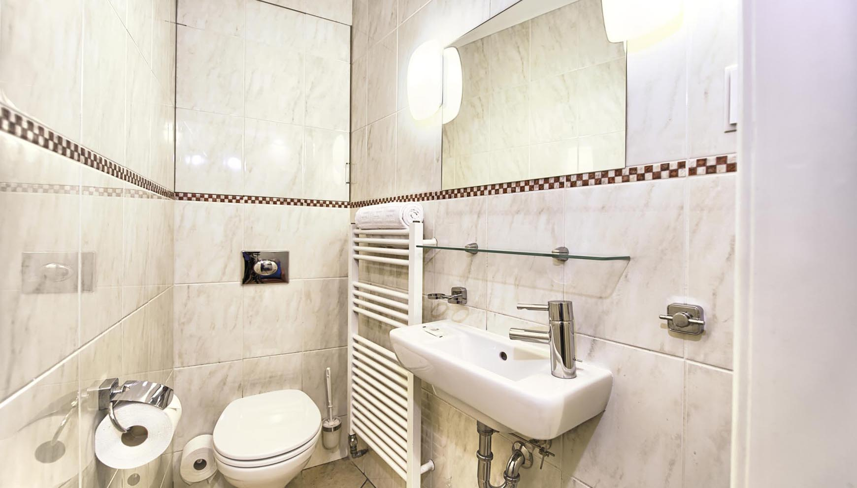Third bathroom with extra toilet in a three bedroom apartment in Residence Brehova